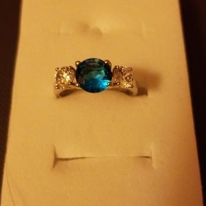 Women's silver ring with blue stone and two white